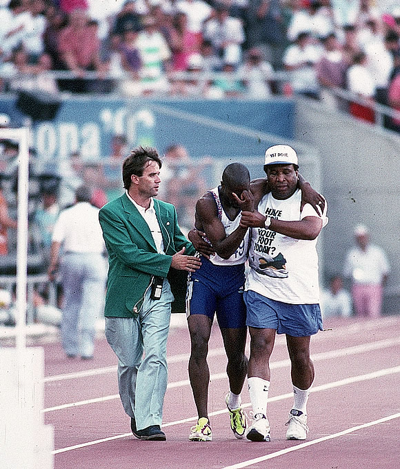 Derek Redmond in the 1992 Olympics - CSD Strength is being able and ready to carry our kid's home, no matter what their age.